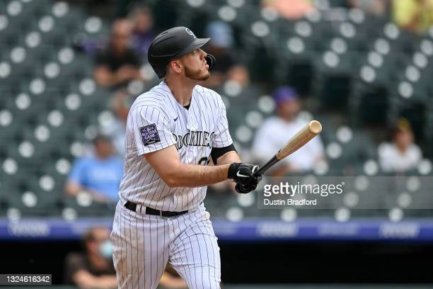 Cron of the Colorado Rockies follows the flight of a first inning 2-run homerun against the San Diego Padres at Coors Field on June 16, 2021 in...
