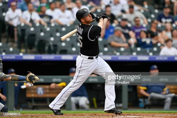 Cron of the Colorado Rockies follows the flight of a first inning grand slam homerun against the Milwaukee Brewers at Coors Field on June 17, 2021 in...