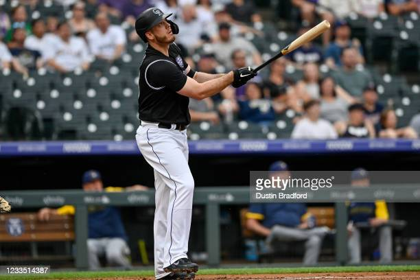 Cron of the Colorado Rockies hits a first-inning grand slam home run against the Milwaukee Brewers at Coors Field on June 17, 2021 in Denver,...