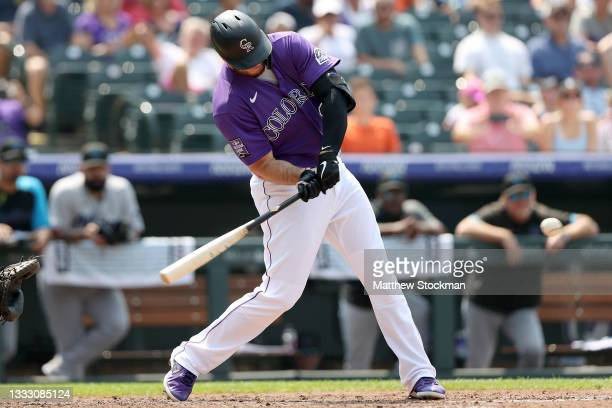 Cron of the Colorado Rockies hits a grand slam home run against the Miami Marlins in the fourth inning at Coors Field on August 08, 2021 in Denver,...