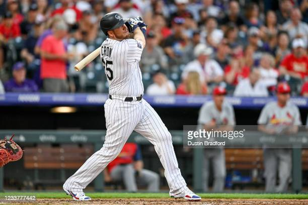 Cron of the Colorado Rockies hits a sixth inning RBI double against the St. Louis Cardinals at Coors Field on July 2, 2021 in Denver, Colorado.