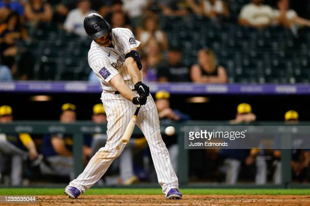 Cron of the Colorado Rockies hits a walk-off RBI single during the tenth inning against the Milwaukee Brewers at Coors Field on June 18, 2021 in...