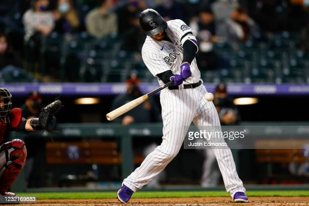 Cron of the Colorado Rockies hits an RBI double during the third inning against the Arizona Diamondbacks at Coors Field on April 7, 2021 in Denver,...