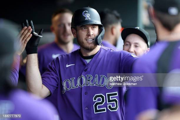 Cron of the Colorado Rockies is congratulated in the dugout after hitting a solo home run against the Miami Marlins in the second inning at Coors...