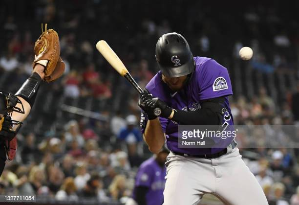 Cron of the Colorado Rockies is hit in the head with a pitch from Riley Smith of the Arizona Diamondbacks during the seventh inning at Chase Field on...