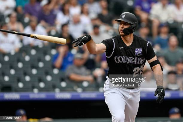 Cron of the Colorado Rockies tosses his bat after hitting a first-inning grand slam home run against the Milwaukee Brewers at Coors Field on June 17,...