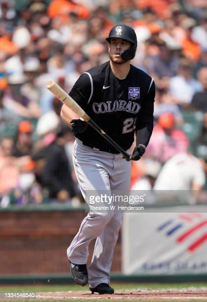 Cron of the Colorado Rockies tosses his bat away after drawing a walk against the San Francisco Giants in the top of the fourth inning at Oracle Park...