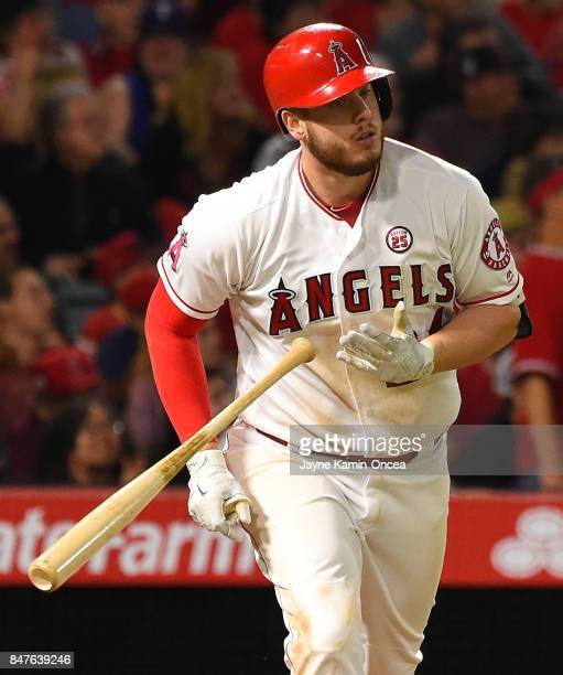 J Cron of the Los Angeles Angels of Anaheim drops his bat after hitting a two run home run in the sixth inning of the game against the Texas Rangers...