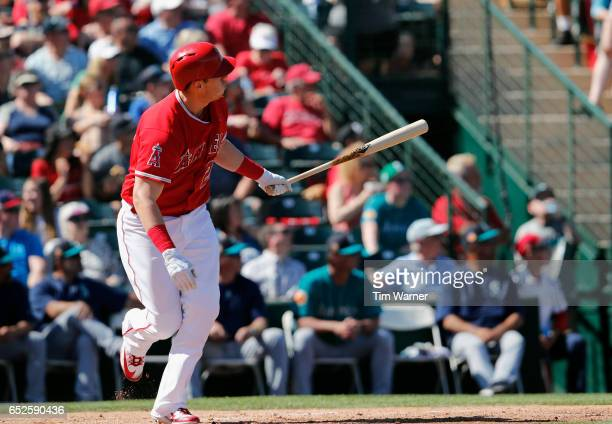 J Cron of the Los Angeles Angels of Anaheim hits a home run in the second inning against the Seattle Mariners during a spring training game at Tempe...