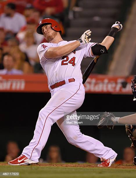 J Cron of the Los Angeles Angels of Anaheim hits a solo home run during the seventh inning of the game against the New York Yankees at Angel Stadium...