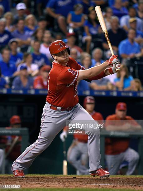 J Cron of the Los Angeles Angels of Anaheim hits a tworun double in the ninth inning against the Kansas City Royals at Kauffman Stadium on August 13...