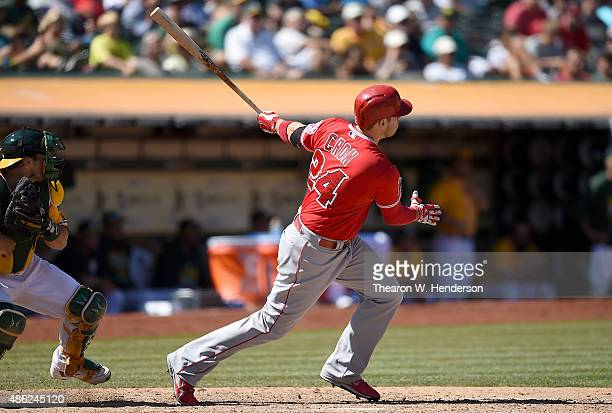 J Cron of the Los Angeles Angels of Anaheim hits an rbi double scoring Collin Cowgill against the Oakland Athletics in the top of the eighth inning...