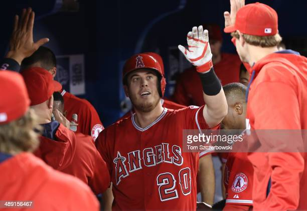 J Cron of the Los Angeles Angels of Anaheim is congratulated by teammates in the dugout after hitting a solo home run in the third inning during MLB...