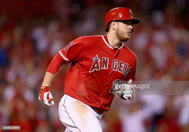 J Cron of the Los Angeles Angels of Anaheim rounds first base after hitting a threerun home run in the seventh inning against the Seattle Mariners at...
