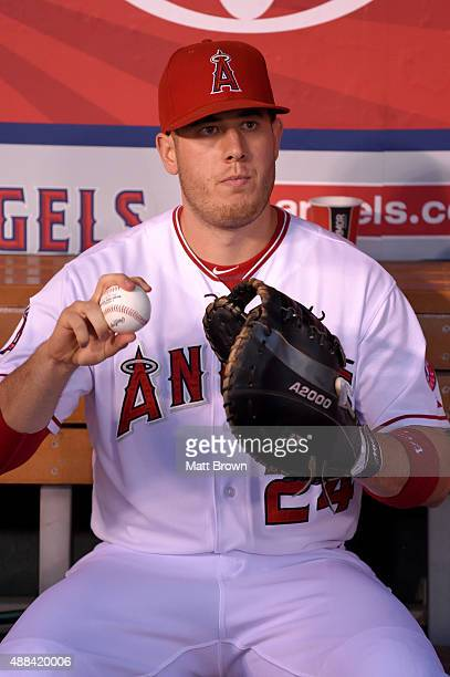 J Cron of the Los Angeles Angels of Anaheim sits in the dugout before the game against the Houston Astros at Angel Stadium of Anaheim on September 11...