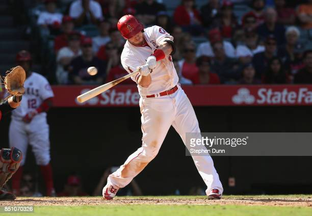 J Cron of the Los Angeles Angels of Anaheim strikes out swinging with the bases loaded in the seventh inning against the Cleveland Indians on...
