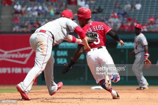 J Cron of the Los Angeles Angels of Anaheim tags out Delino DeShields of the Texas Rangers on a rundown in the first inning of a game at Globe Life...