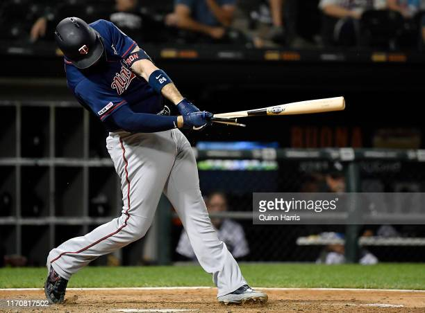 Cron of the Minnesota Twins breaks his bat in the ninth inning against the Chicago White Sox at Guaranteed Rate Field on August 28, 2019 in Chicago,...