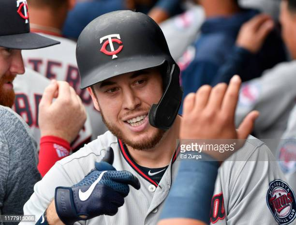 Cron of the Minnesota Twins celebrates his two-run home run with teammates in the first inning against the Kansas City Royals at Kauffman Stadium on...