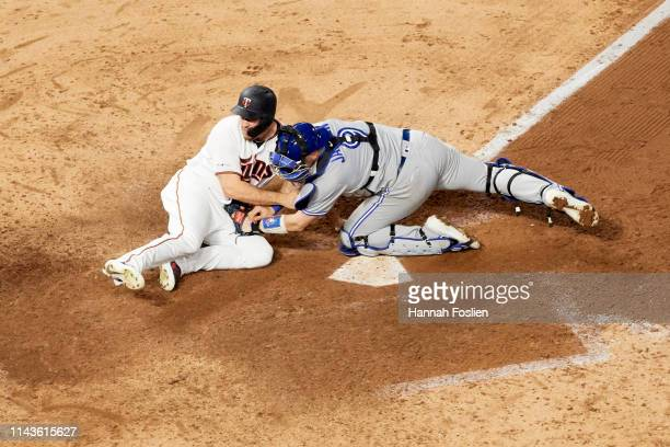 J Cron of the Minnesota Twins is out as Danny Jansen of the Toronto Blue Jays defends home plate during the game on April 16 2019 at Target Field in...