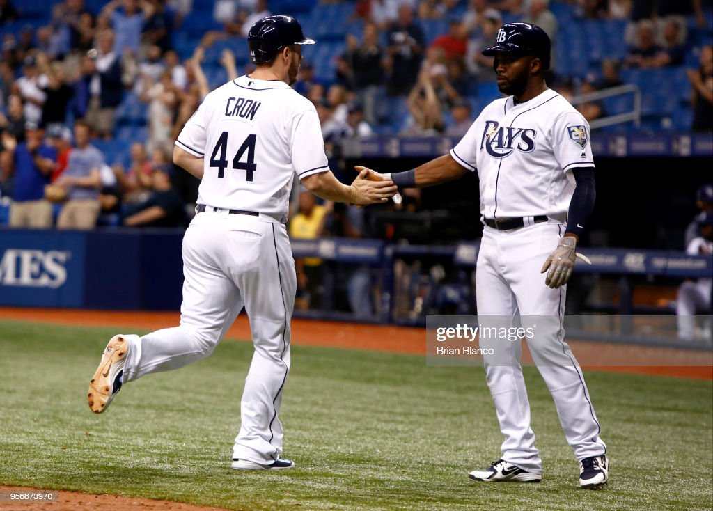 C.J. Cron #44 of the Tampa Bay Rays and Denard Span #2 celebrate after scoring off of a two-run single by Wilson Ramos during the eighth inning of a game against the Atlanta Braves on May 9, 2018 at Tropicana Field in St. Petersburg, Florida.