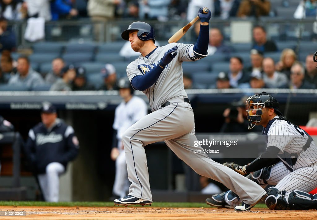 C.J. Cron #44 of the Tampa Bay Rays follows through on a first inning RBI double against the New York Yankees at Yankee Stadium on April 4, 2018 in the Bronx borough of New York City.