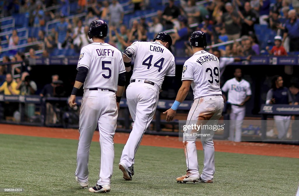 C.J. Cron #44 of the Tampa Bay Rays is congratulated after hitting a three run home run in the seventh inning during a game against the Detroit Tigers at Tropicana Field on July 11, 2018 in St Petersburg, Florida.