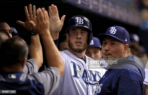 Cron of the Tampa Bay Rays is congratulated after scoring in the second inning during a game against the Philadelphia Phillies at Tropicana Field on...