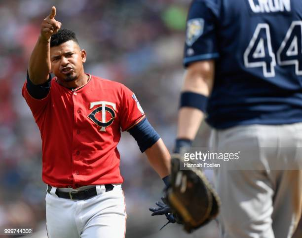J Cron of the Tampa Bay Rays looks on as Eduardo Escobar of the Minnesota Twins yells after the seventh inning of the game causing the benches to...