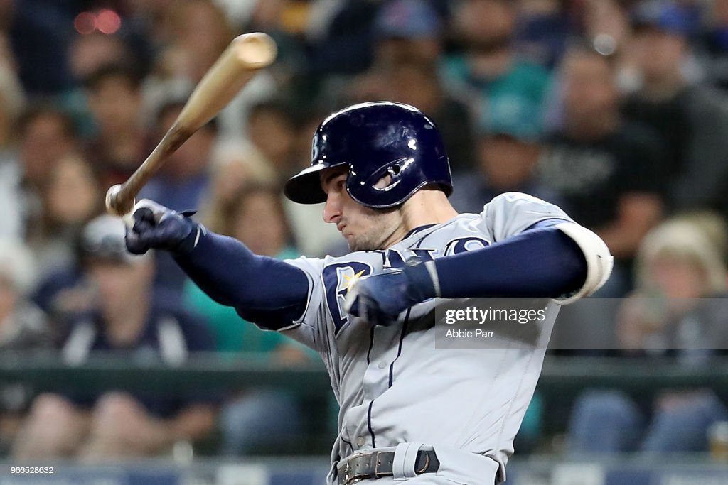 C.J. Cron #44 of the Tampa Bay Rays loses his bat in the eighth inning against the Seattle Mariners during their game at Safeco Field on June 2, 2018 in Seattle, Washington.
