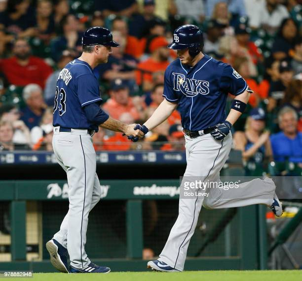 Carlos Gomez of the Tampa Bay Rays high fives Matt Duffy and Adeiny Hechavarria after the final out against the Houston Astros at Minute Maid Park on...