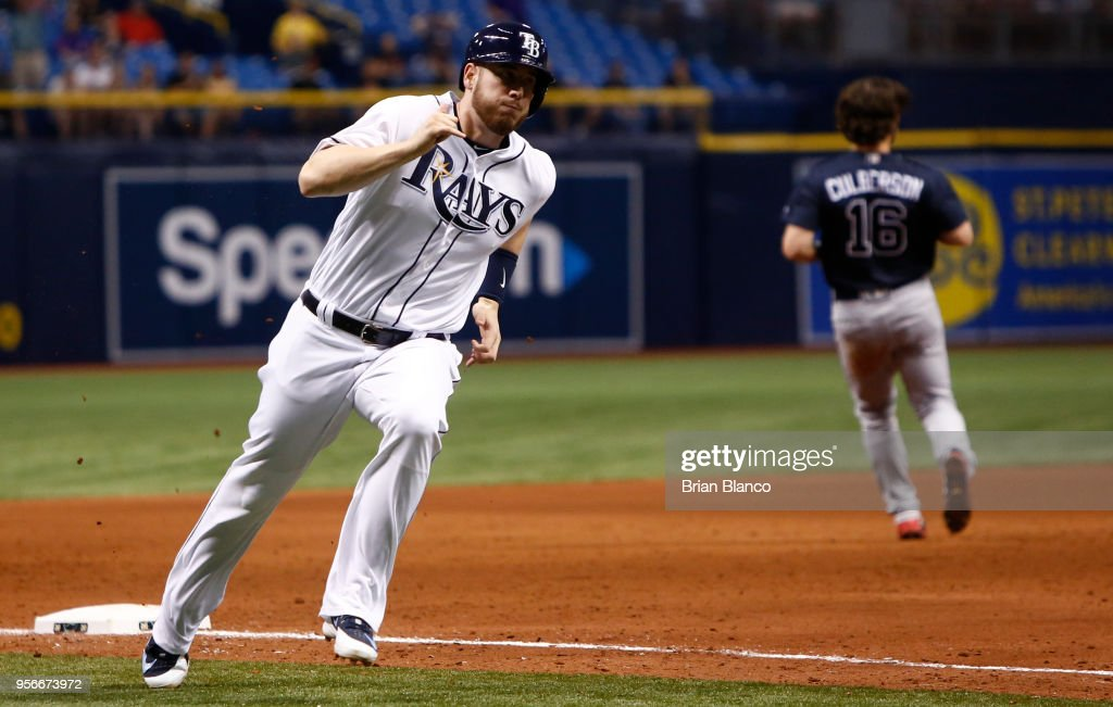 C.J. Cron #44 of the Tampa Bay Rays rounds third base on his way to score off of a two-run single by Wilson Ramos during the eighth inning of a game against the Atlanta Braves on May 9, 2018 at Tropicana Field in St. Petersburg, Florida.