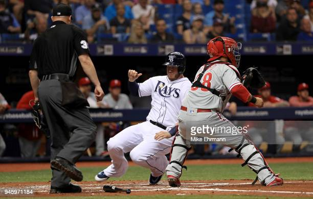 Cron of the Tampa Bay Rays scores a run in front of the tag from Jorge Alfaro of the Philadelphia Phillies in the second inning on a double from...