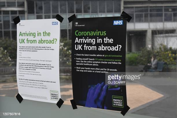 Cronavirus notices are seen at Manchester Airport, Manchester in north west England on March 17 as travel restrictions due to the novel coronavirus...
