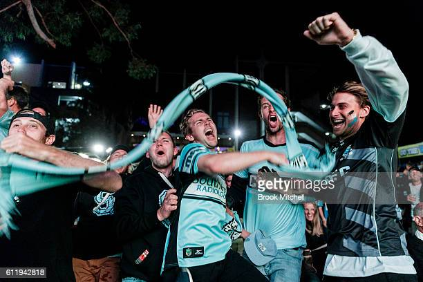 Cronulla Sharks fans at Southern Cross Group Stadium celebrate the Sharks' victory in the 2016 NRL Grand Final on October 2 2016 in Sydney Australia
