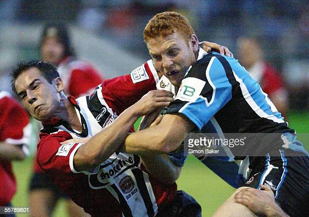 Cronulla Sharks forward Keith Galloway fends off Canterbury Bulls Jimmy O'Brien during their pre season warm up match at Rugby League Park in...
