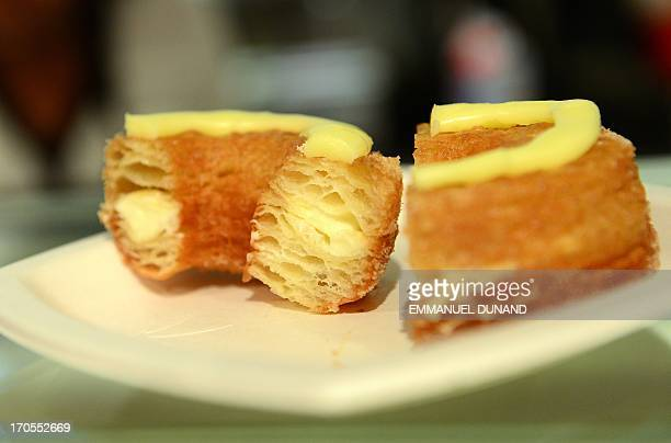 A cronut a croissantdoughnut hybrid the brain child of French pastry chef Dominique Ansel sit on a plate at Ansel's bakery shop in New York June 14...