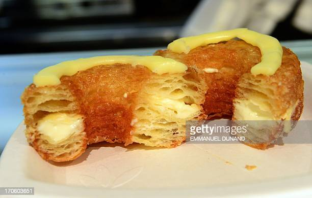A cronut a croissantdoughnut hybrid the brain child of French pastry chef Dominique Ansel sit on a plate at Ansel's bakery shop in New York on June...