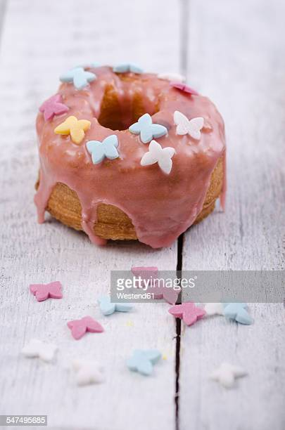 Cronut with icing on wooden table