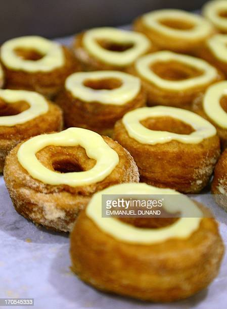 Cronuts a croissantdoughnut hybrid the brain child of French pastry chef Dominique Ansel sit on a baking tray at Ansel's bakery shop in New York June...