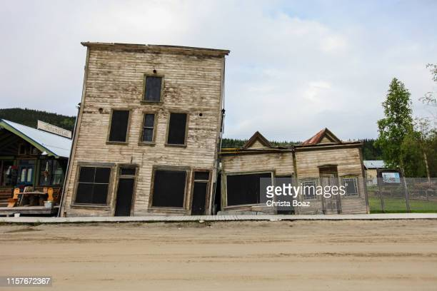 crooked buildings - permafrost stock pictures, royalty-free photos & images