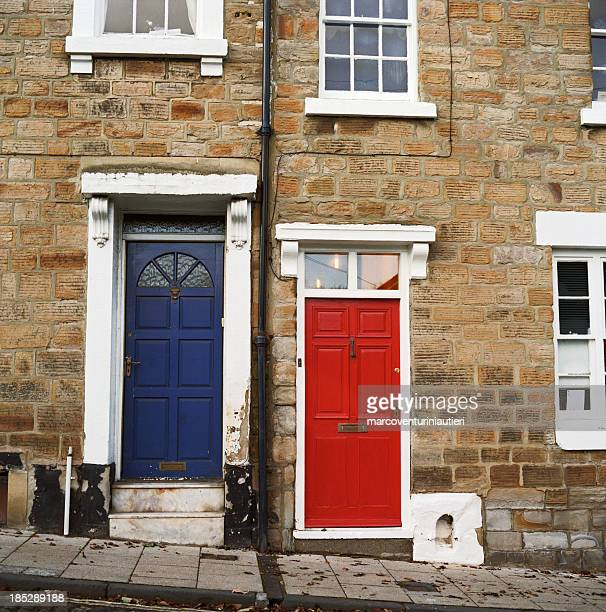 Crooked homes with red and blue doors