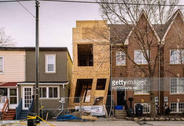 Crooked house in construction