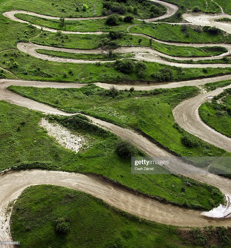 Crooked serpentine road of motocross track : Stock Photo