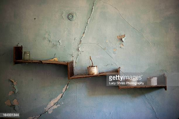 Crooked shelves in an abandoned building