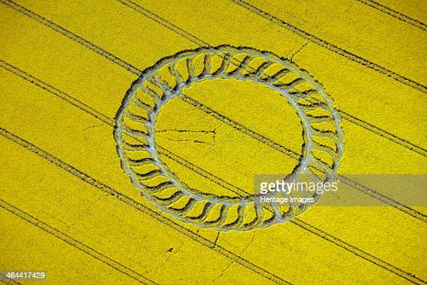 Crop circle near West Kennet Wiltshire 1998 Some people regard crop circles as evidence of UFO contact or spiritual activity Others believe they are...