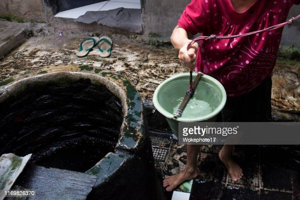 crop hand woman pouring water - world water day stock pictures, royalty-free photos & images