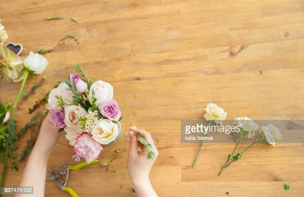 Crop hands of florist making bouquet