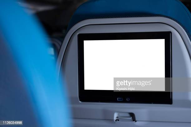 crop image of airplane screen device for entertainment to serve passenger - vehicle seat stock pictures, royalty-free photos & images