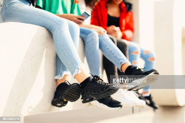 Crop of teenage girls legs and feet